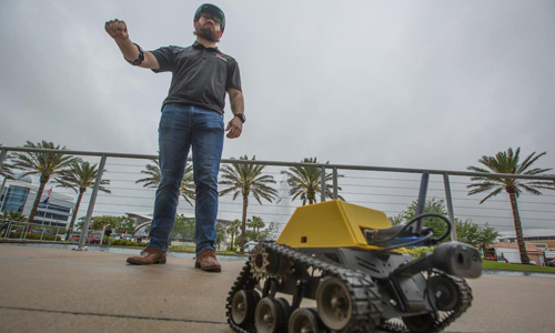 Adam Berlier demonstrates new wearable technology system to operate remote vehicles
